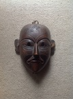 Wooden mask of a hunter