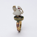 A Gold and Enamel Ring in the form of a Bird
