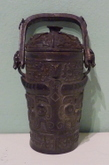 A miniature Chinese bronze You with cover