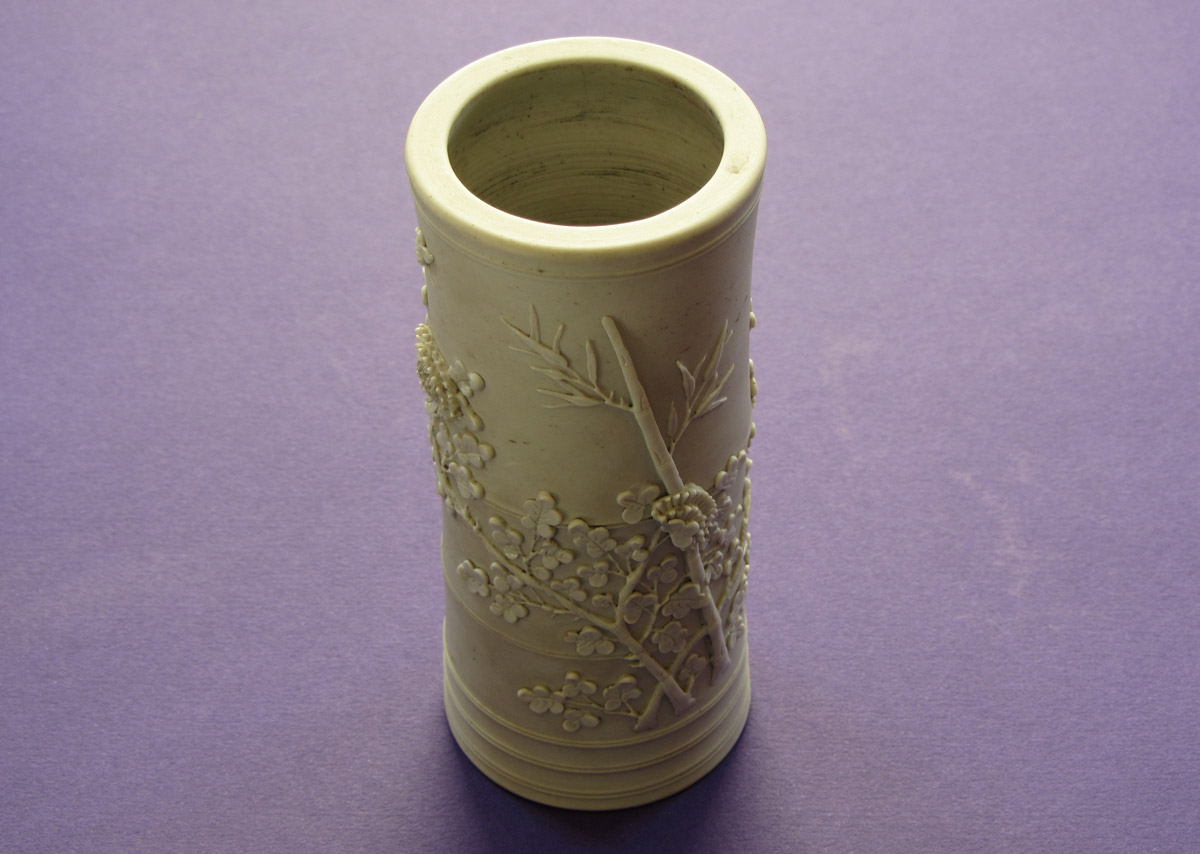 A brush holder with bamboo and chrysanthemum carved in low relief
